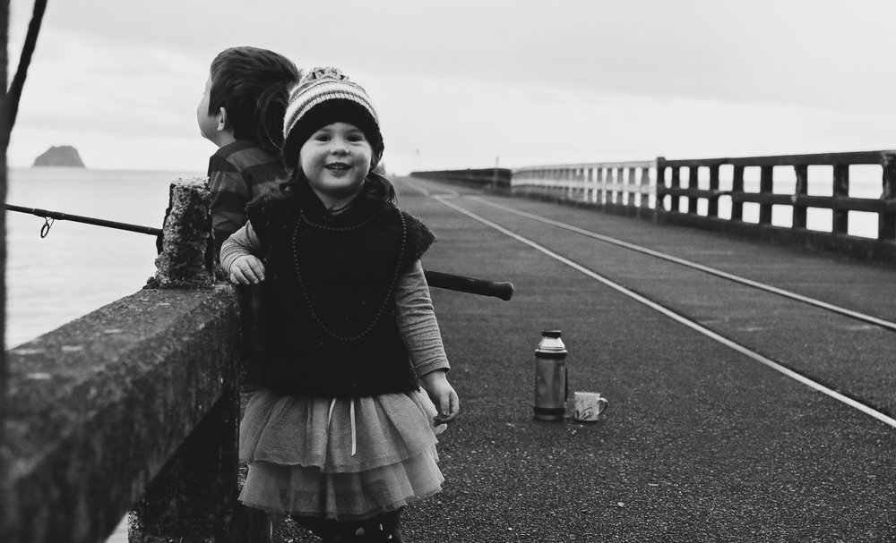 little-girl-little-boy-winter-sunrise-black-and-white-photo-hoping-to-catch-dinner.jpg