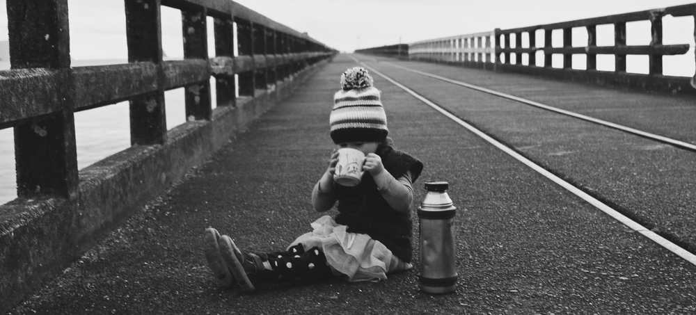 little-girl-winter-sunrise-enjoying-a-hot-cuppa-keeping-her-hands-warm.jpg