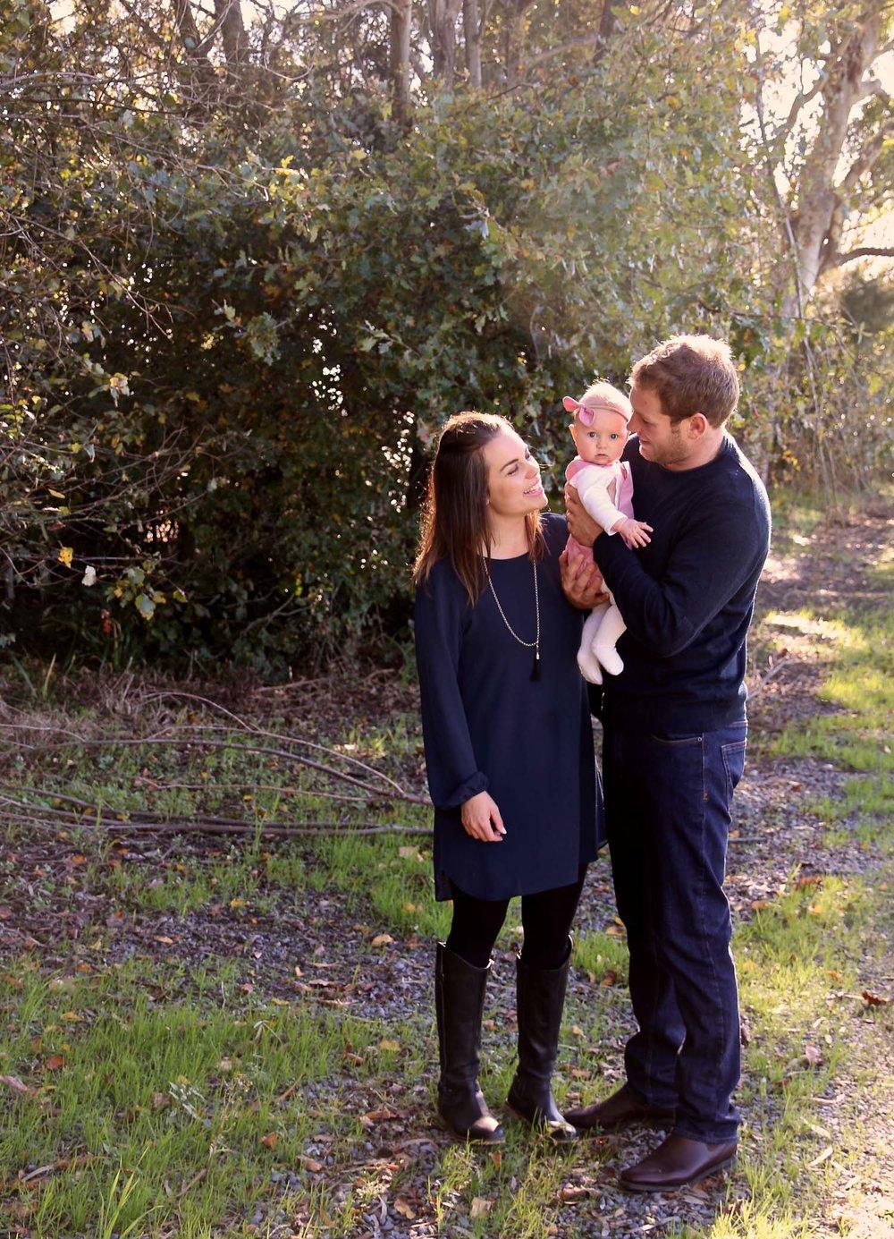 family-of-three-smiles-all-round.jpg