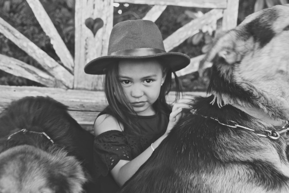black-and-white-image-of-girl-and-her-favourite-farm-dogs-love-seat-behind-her_L-R.jpg