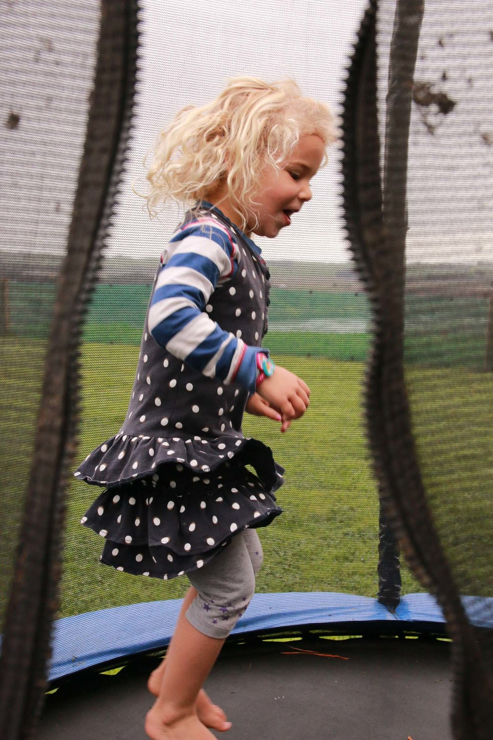 blonde-girl-jumping-on-trampoline-wearing-dress.jpg