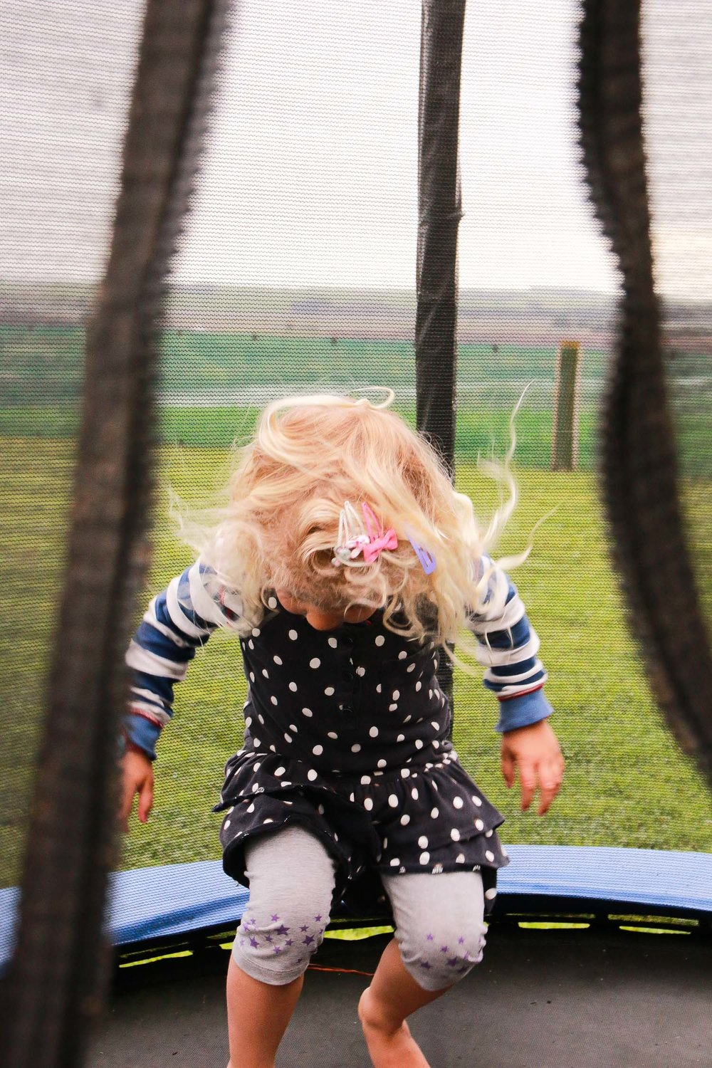 girl-jumping-on-trampoline.jpg