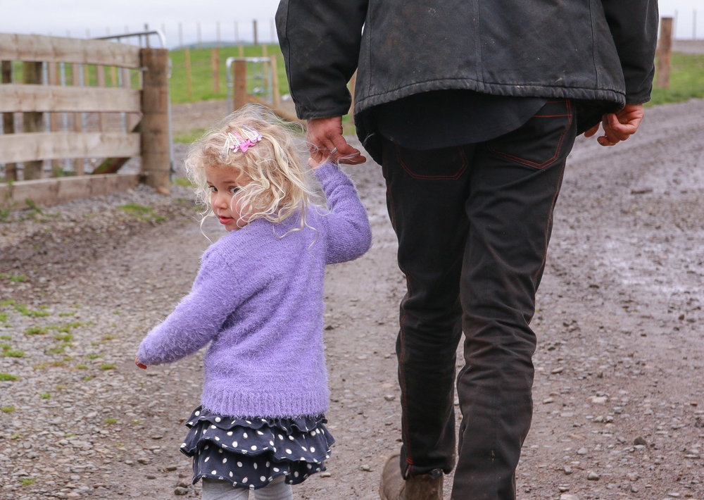little-girl-with-dad-walking-away-looking-back.jpg