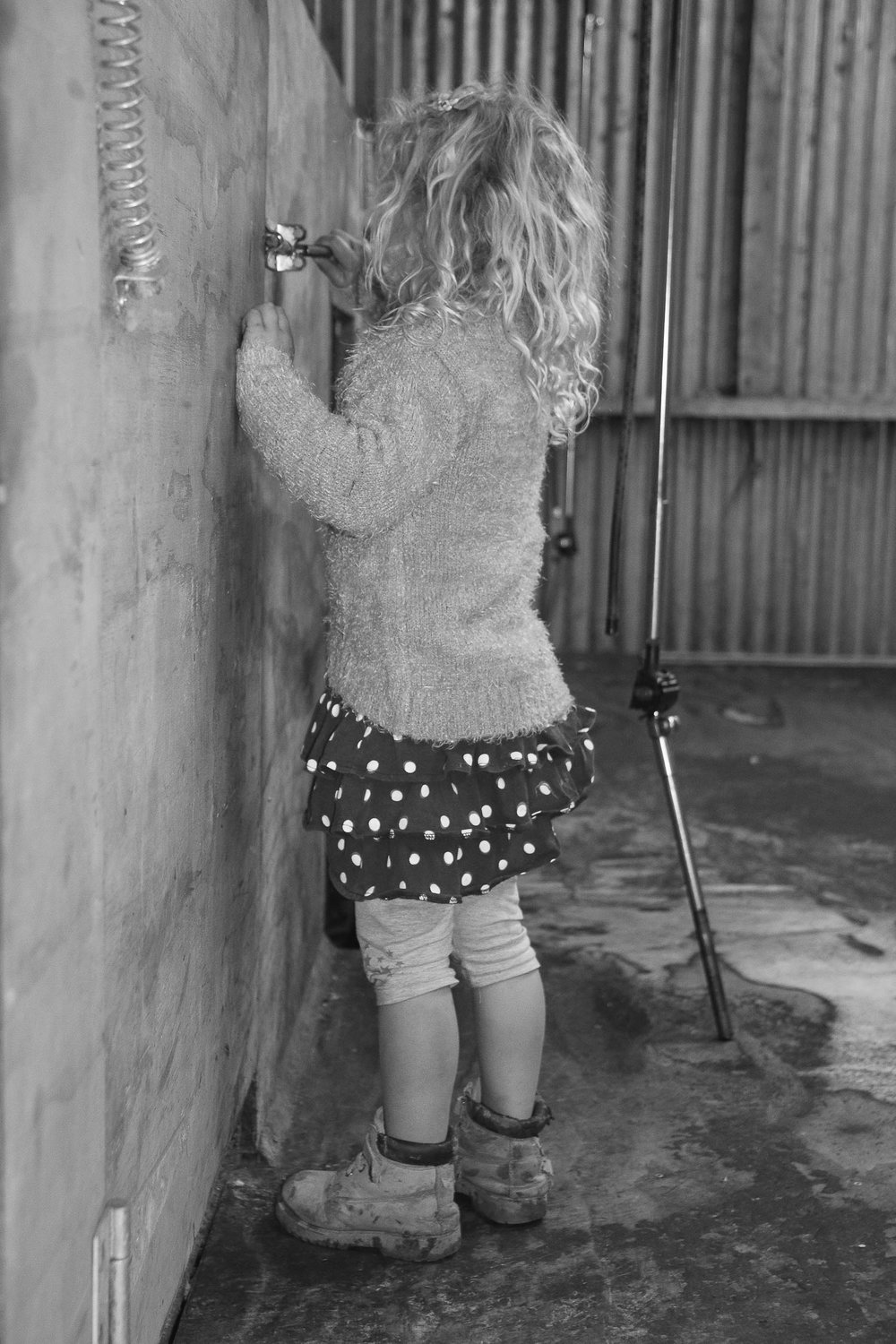 little-girl-playing-in-shearing-shed