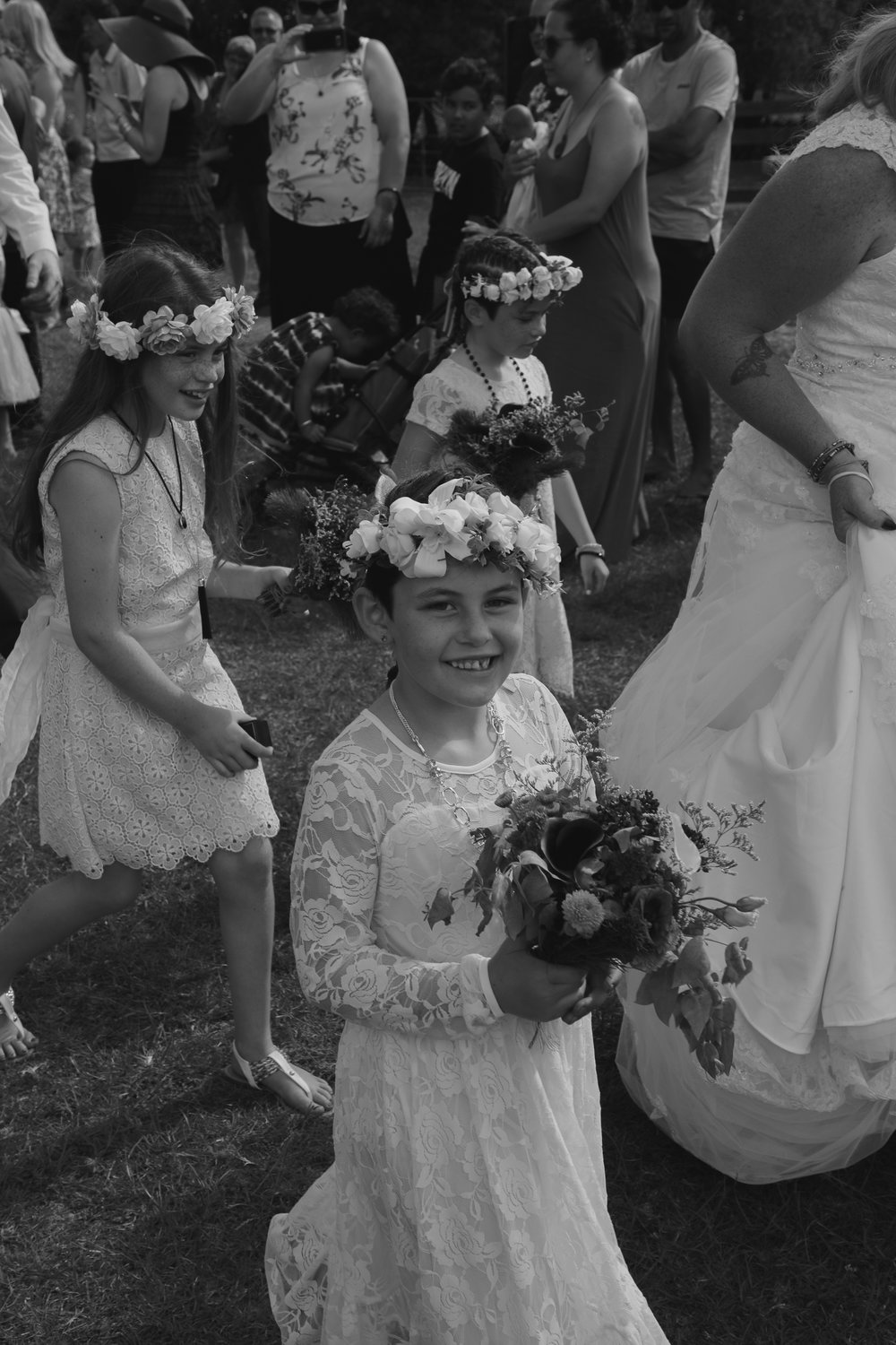 wedding-photography-flower-girls-walking-with-precession.jpg