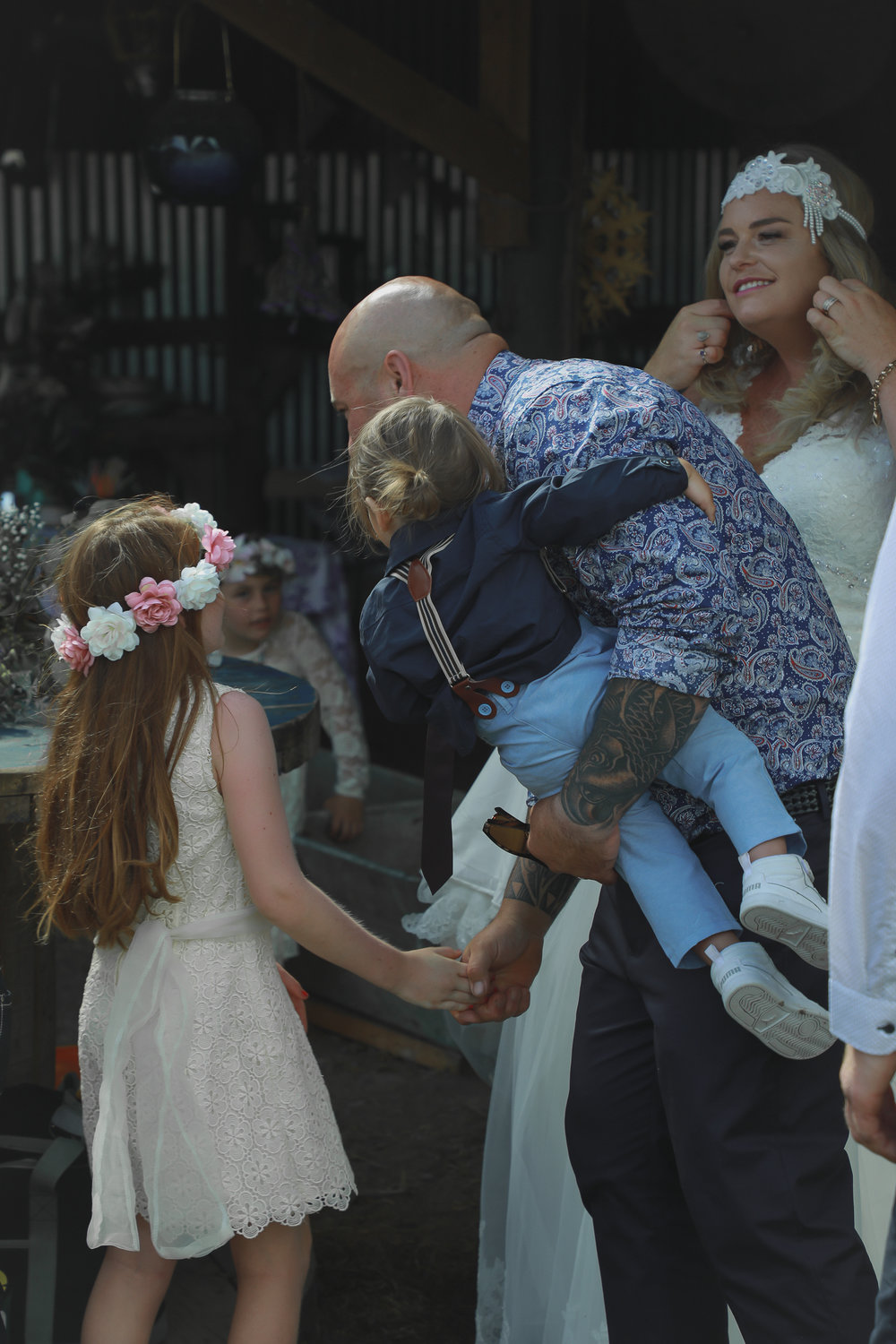 wedding-photography-groom-kissing-kids.jpg