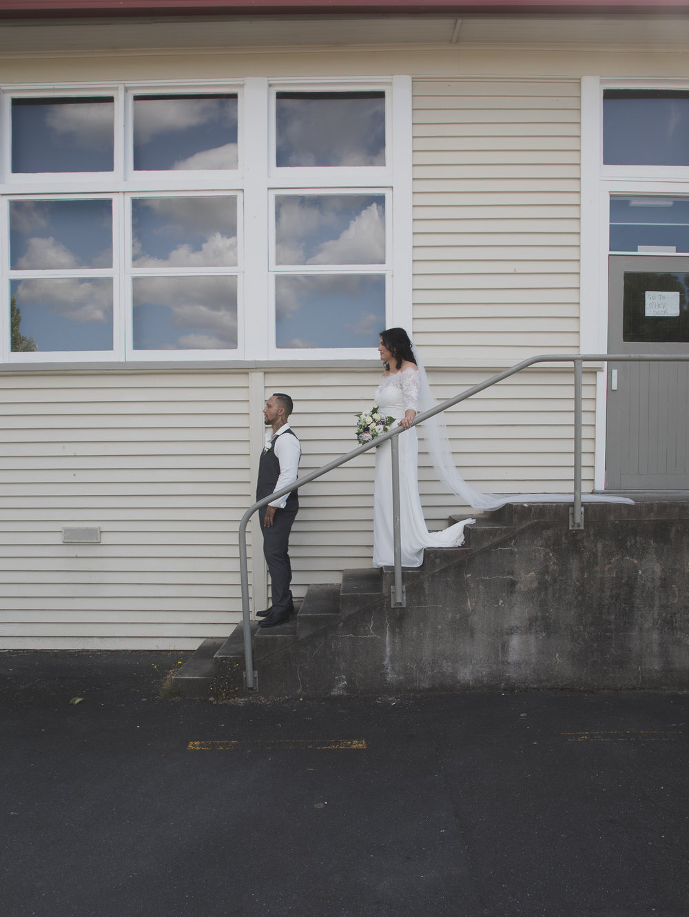 bride and groom at old high school