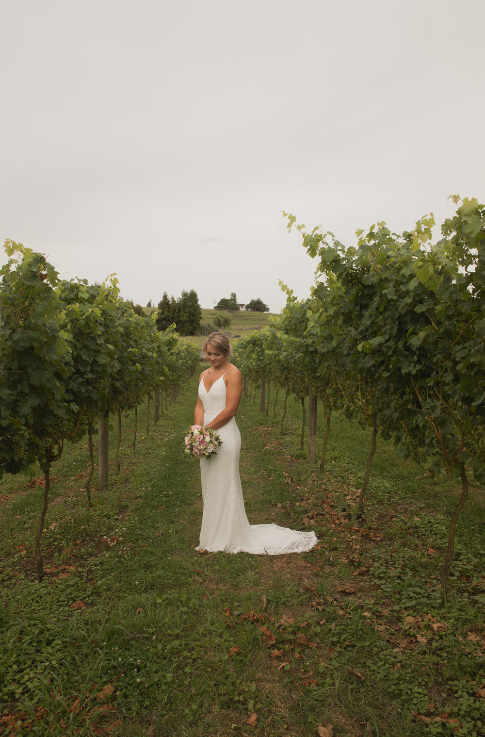 bride in vines on wedding day