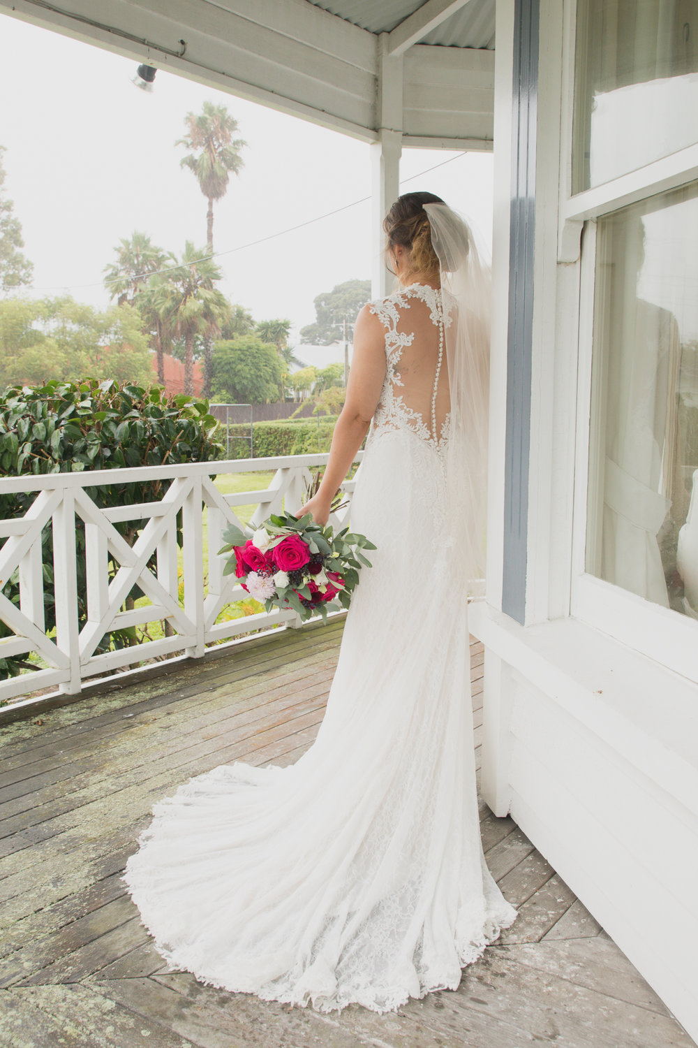 bride on villa veranda