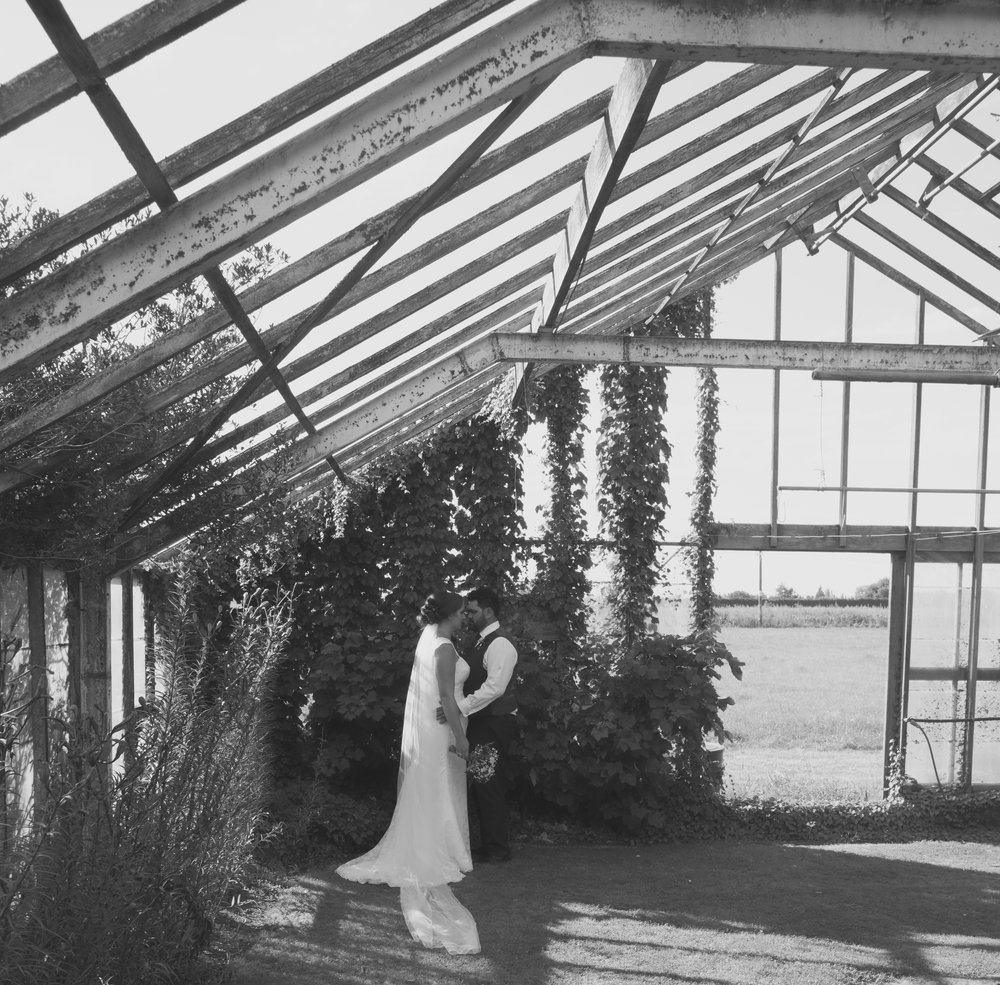 bride and groom in abandoned glasshouse on wedding day