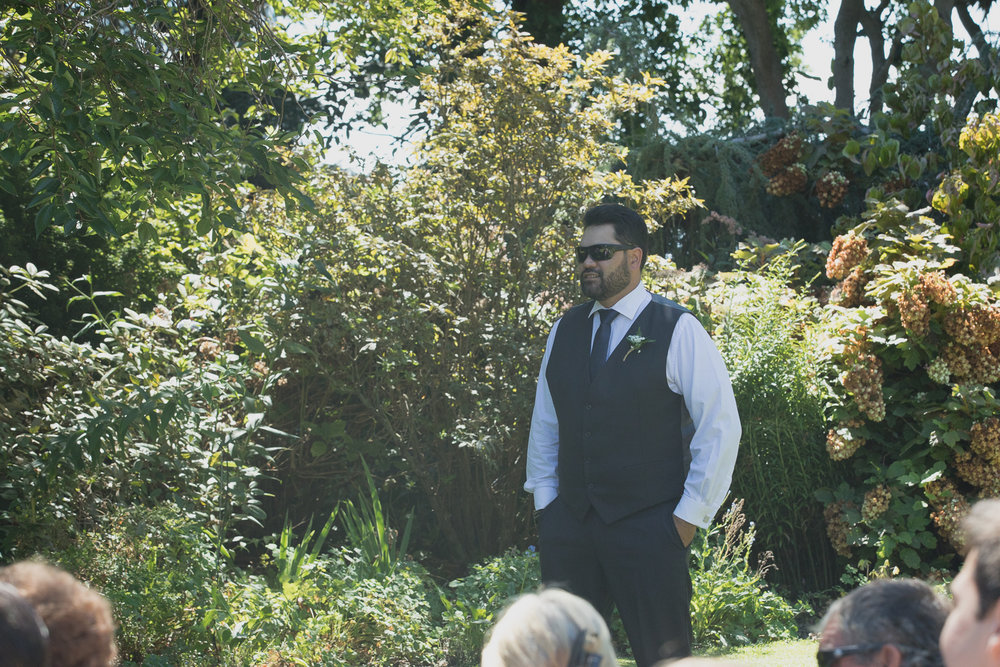 groom at alter ready for bride at wedding ceremony