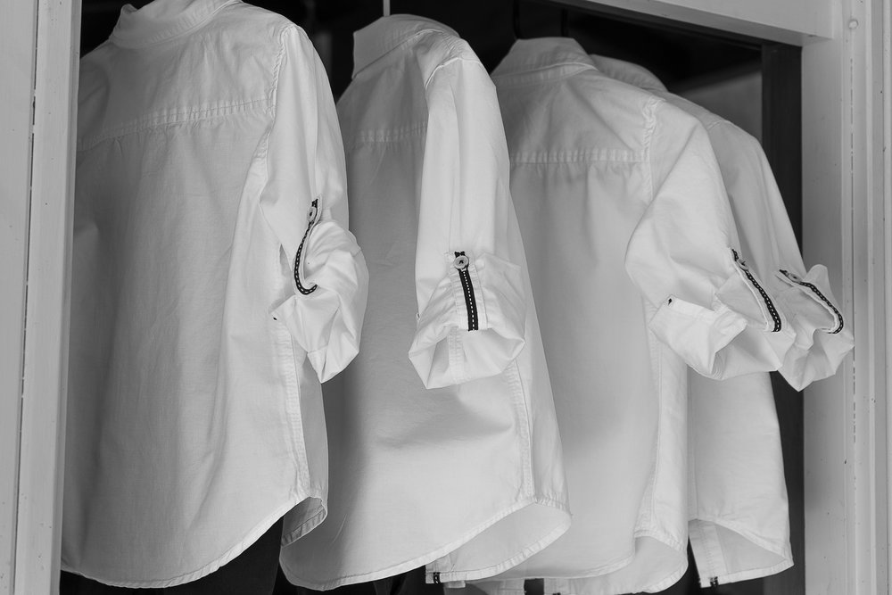groomsmen's shirts hanging up ready for wedding
