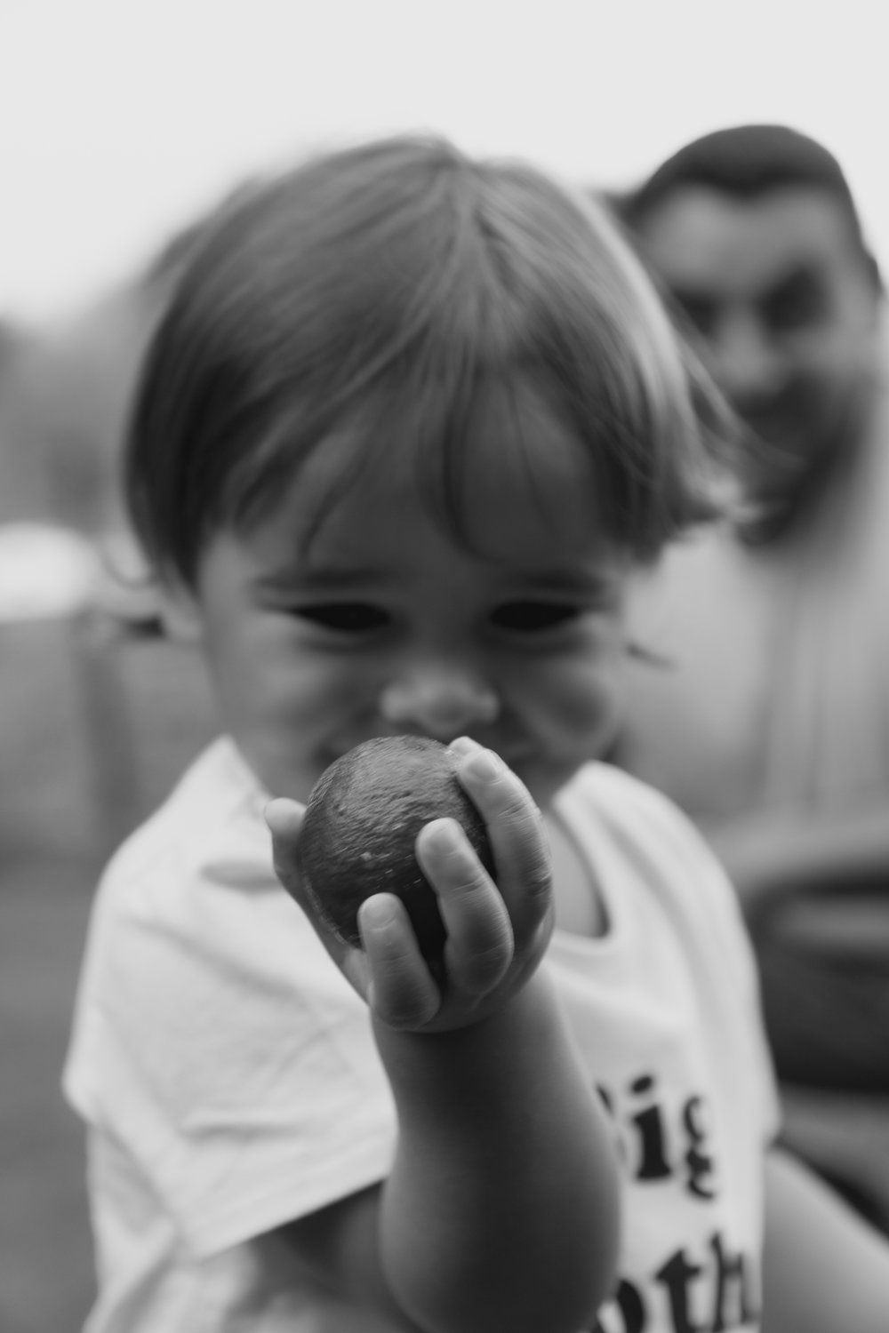 little boy with fruit