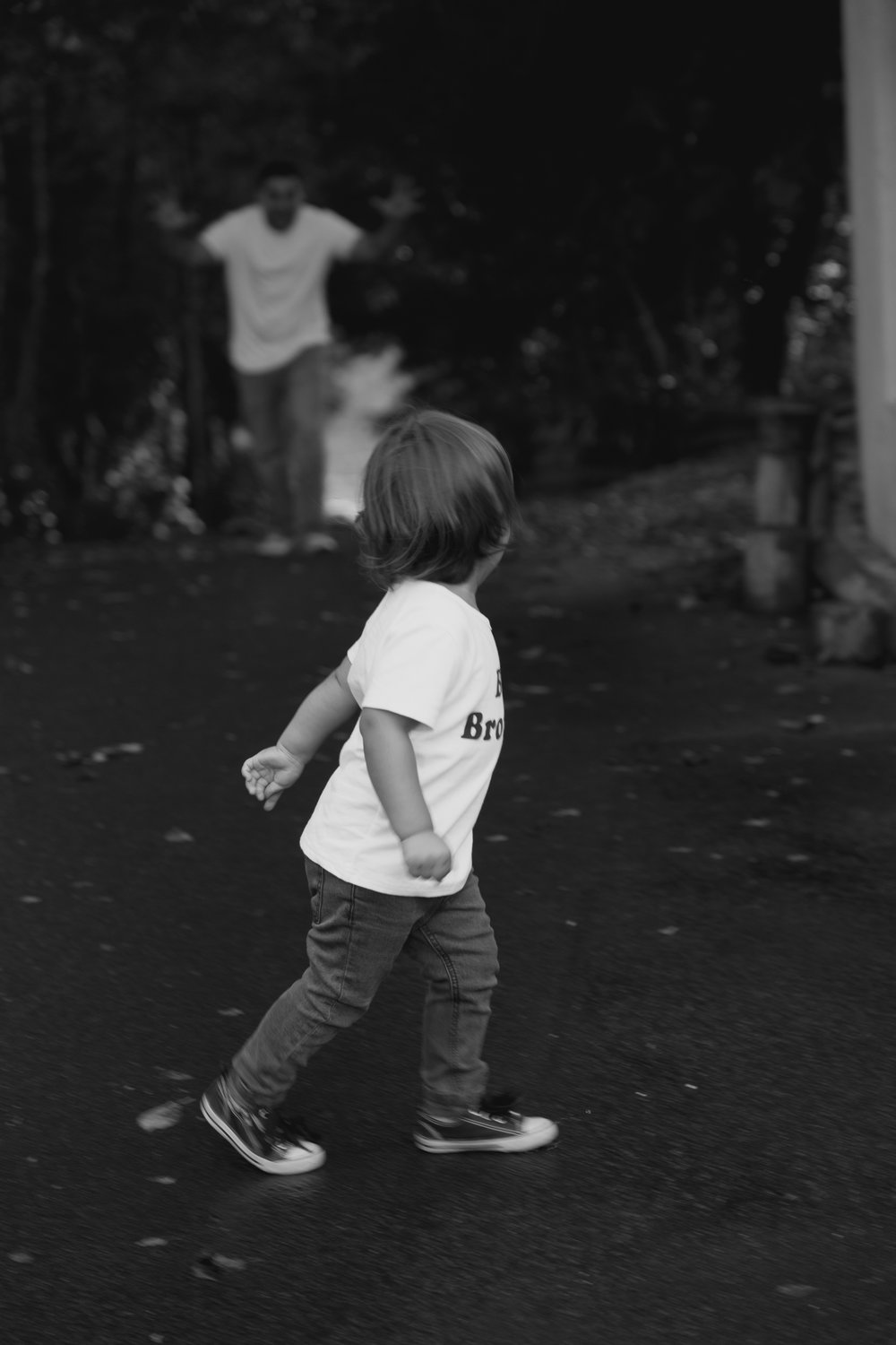 little boy running with dad