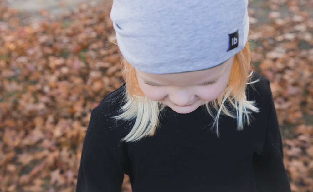 little girl wearing Luca Brocolini merino beanie