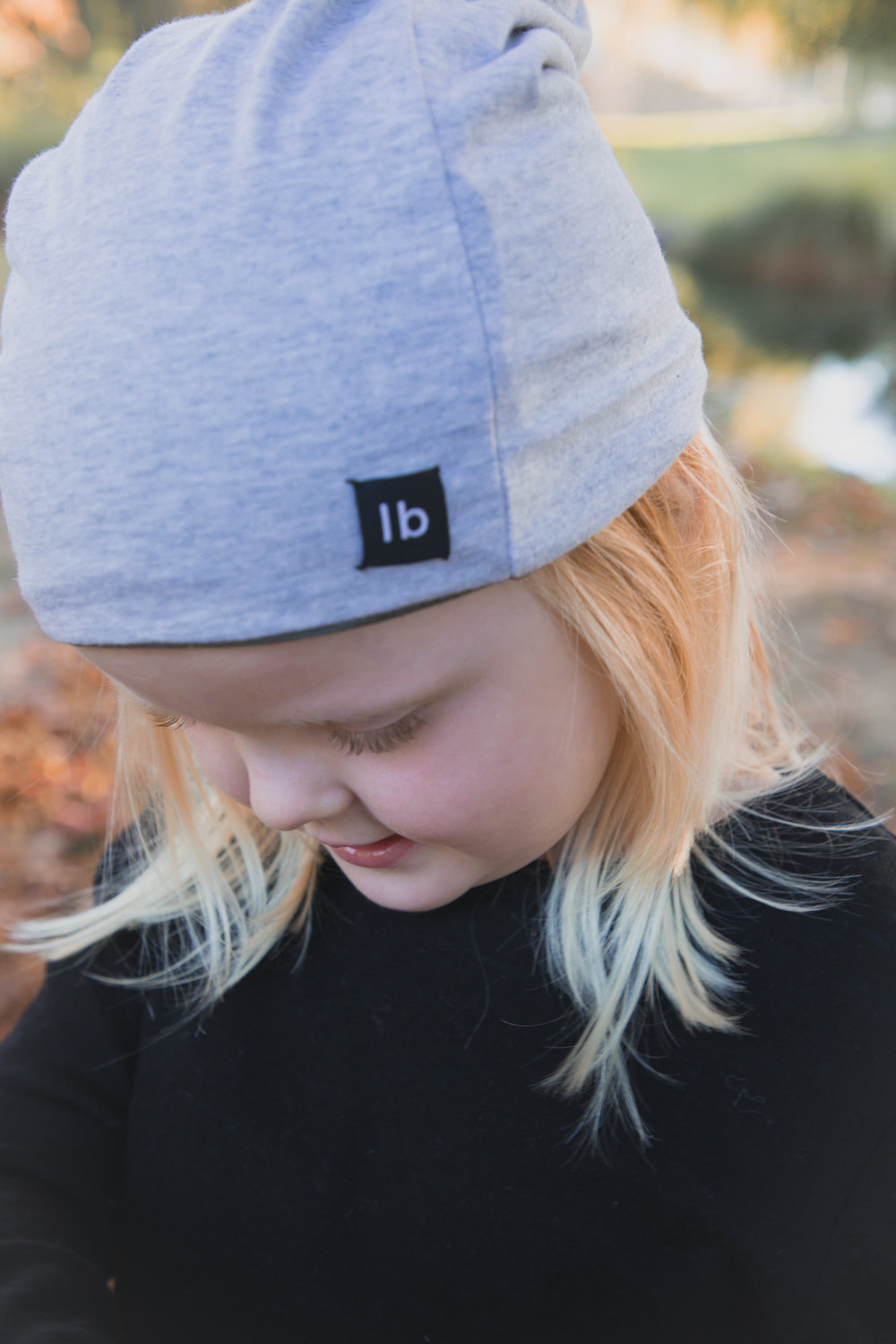 little-girl-playing-in-autumn-wearing-merino-beanie.jpg