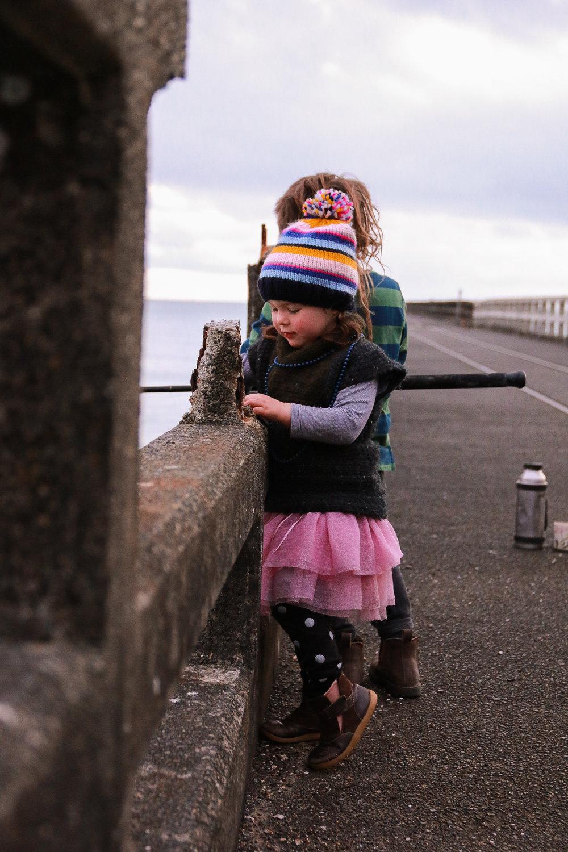 little-girl-fishing-off-the-tolaga-bay-wharf-at-sunrise.jpg