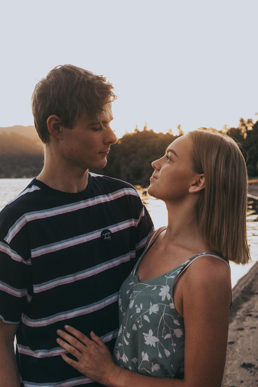 young couple in love at sunset at Lake Okareka