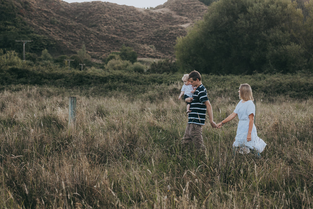 young couple in love at sunset rural New Zealand