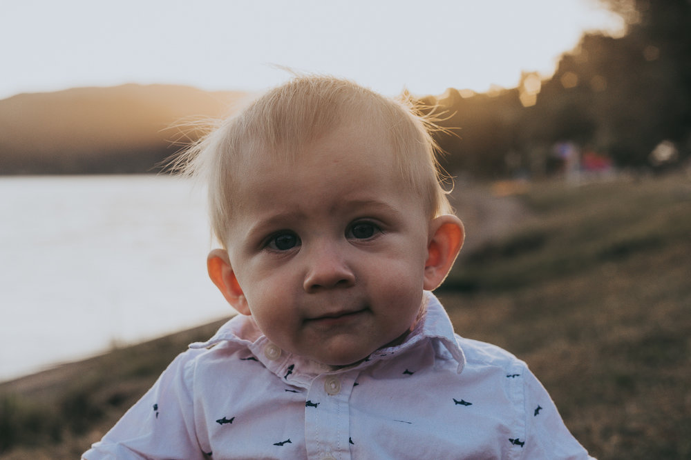 family-photographer-new-zealand-sunset-little-boy-looking-at-the-camera.jpg