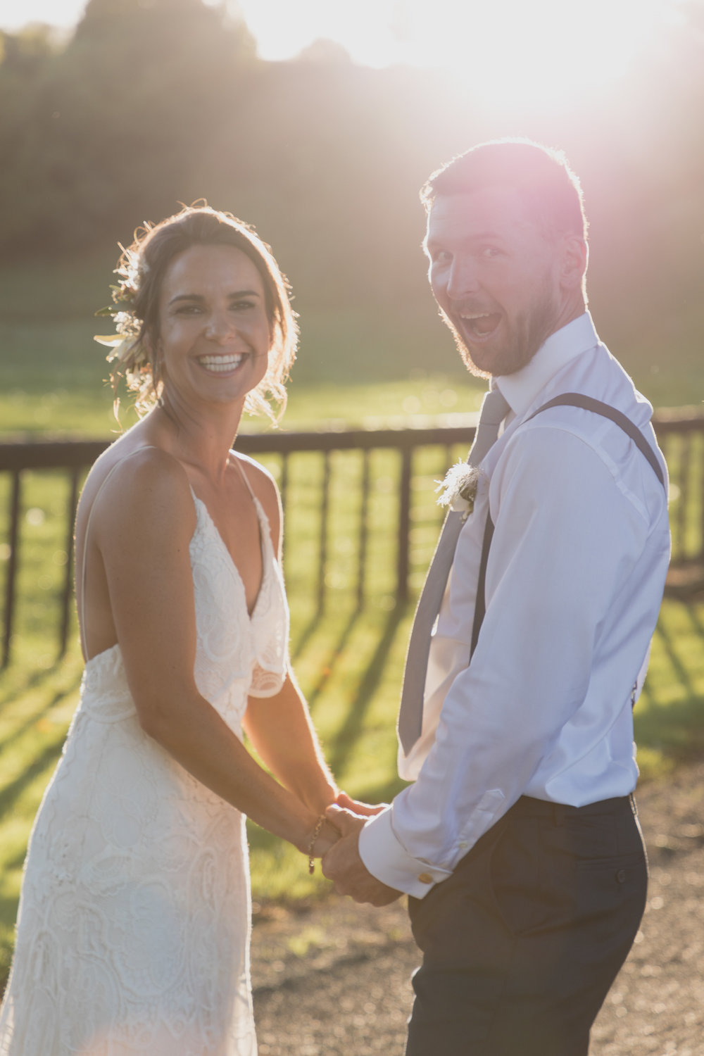 wedding-at-the-red-barn-new-zealand-wedding-photographer-bride-and-groom-laughing-together-playingjpg.jpg