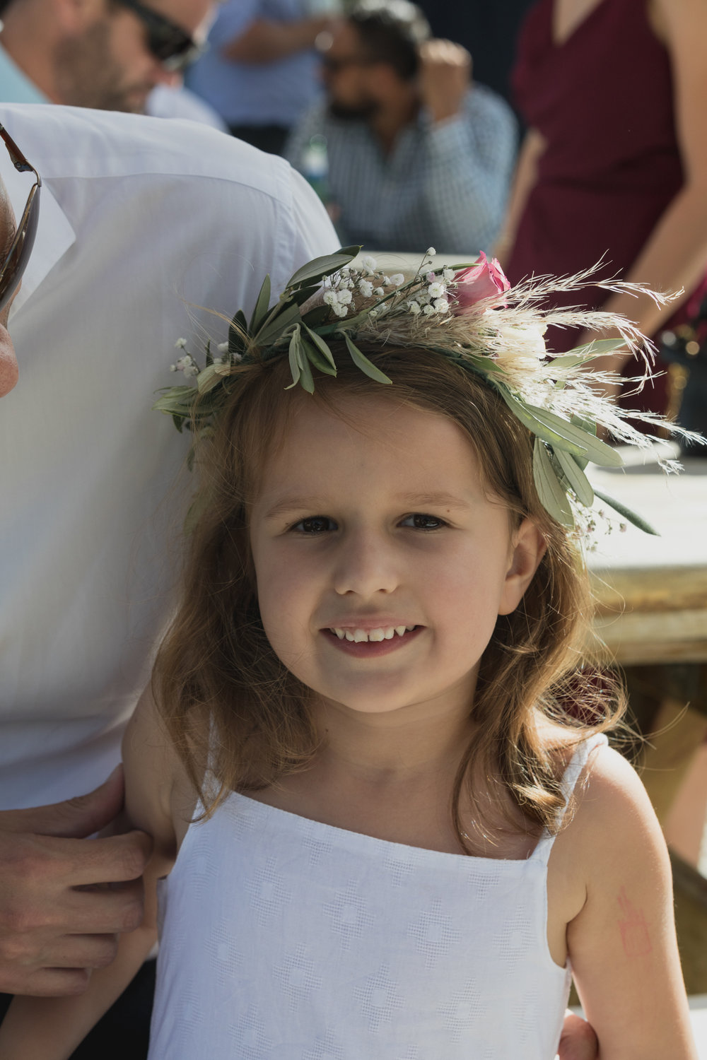 wedding-at-the-red-barn-new-zealand-wedding-photographer-flower-girl-wearing-flower-crown.jpg