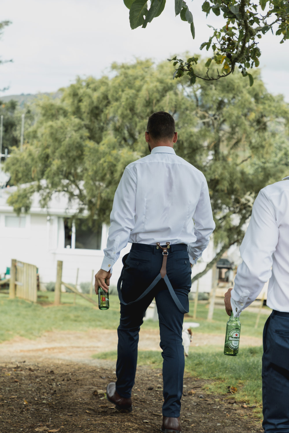 wedding-at-the-red-barn-new-zealand-wedding-photographer-groom-having-a-beer.jpg