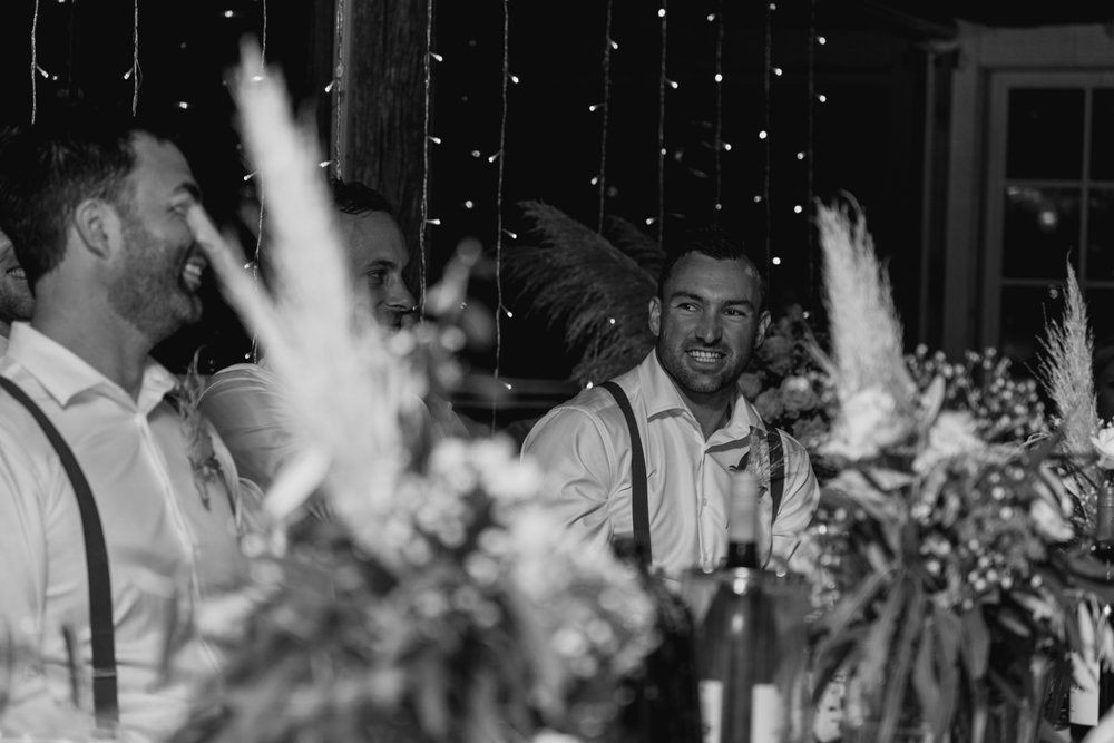 wedding-at-the-red-barn-new-zealand-wedding-photographer-groom-laughing.jpg