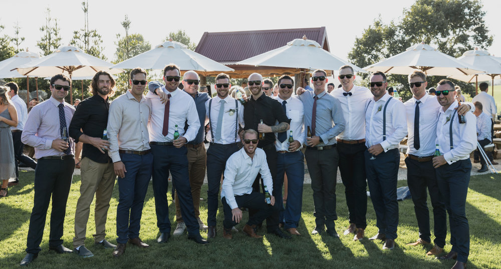 wedding-at-the-red-barn-new-zealand-wedding-photographer-groom-with-all-his-friends.jpg