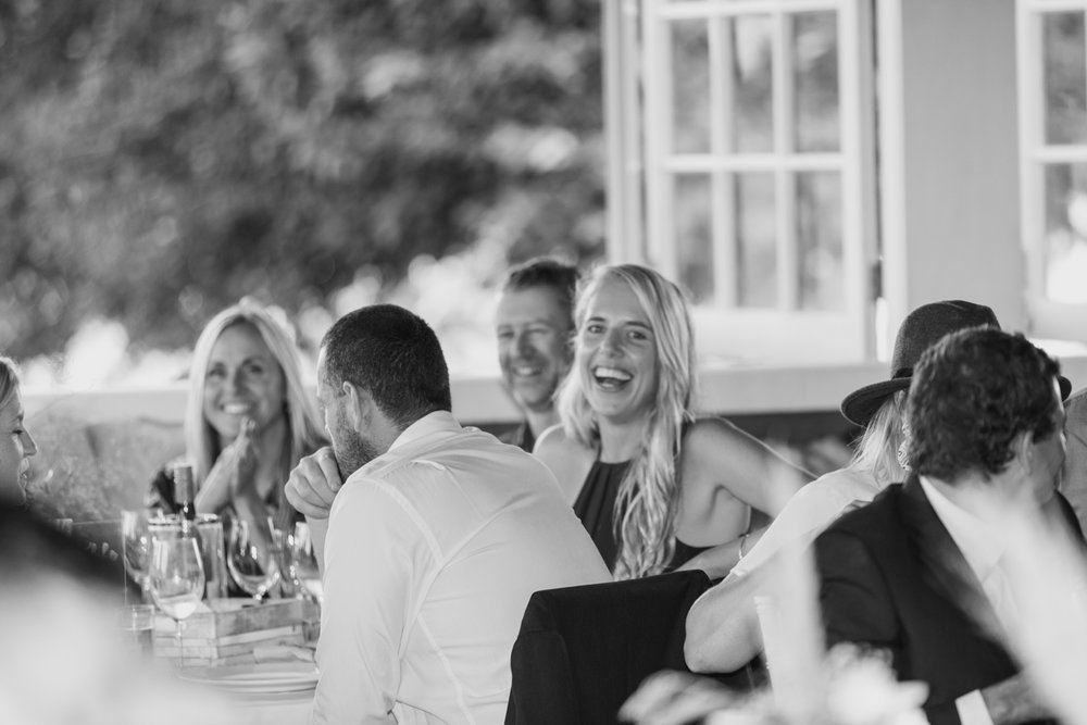 wedding-at-the-red-barn-new-zealand-wedding-photographer-guests-laughing.jpg