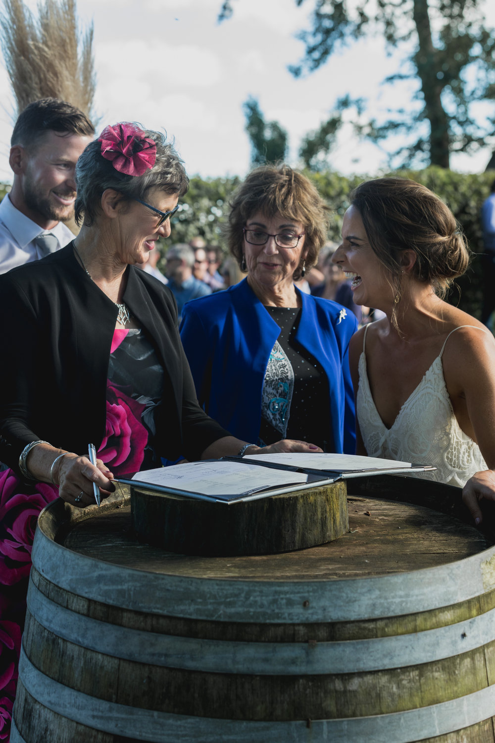 wedding-at-the-red-barn-new-zealand-wedding-photographer-mums-signing-register.jpg