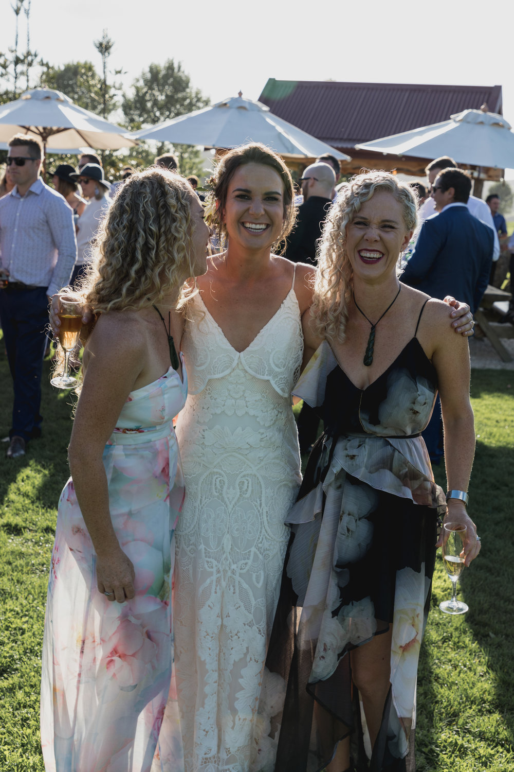 wedding-at-the-red-barn-new-zealand-wedding-photographer-twins-laughing-together-with-bride-at-sunset.jpg