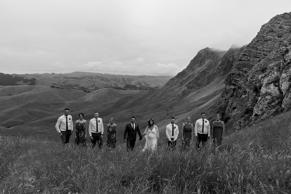 black-barn-winery-wedding-hawkes-bay-wedding-photographer-bride-and-groom-together-up-te-mata-peak-with-bridal-partyy.jpg