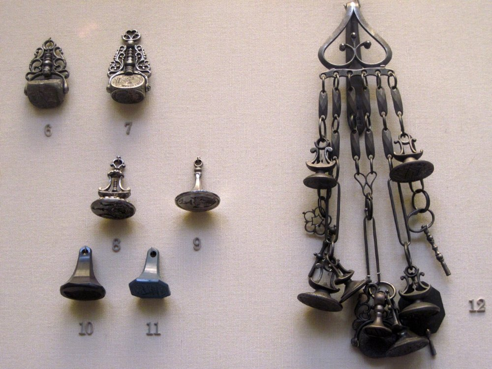 """Chatelaine with seals (mid-late 18th century) "", by  aehdeschaine on Flickr . Taken at the British Museum. Licensed under  CC BY-ND 2.0 ."