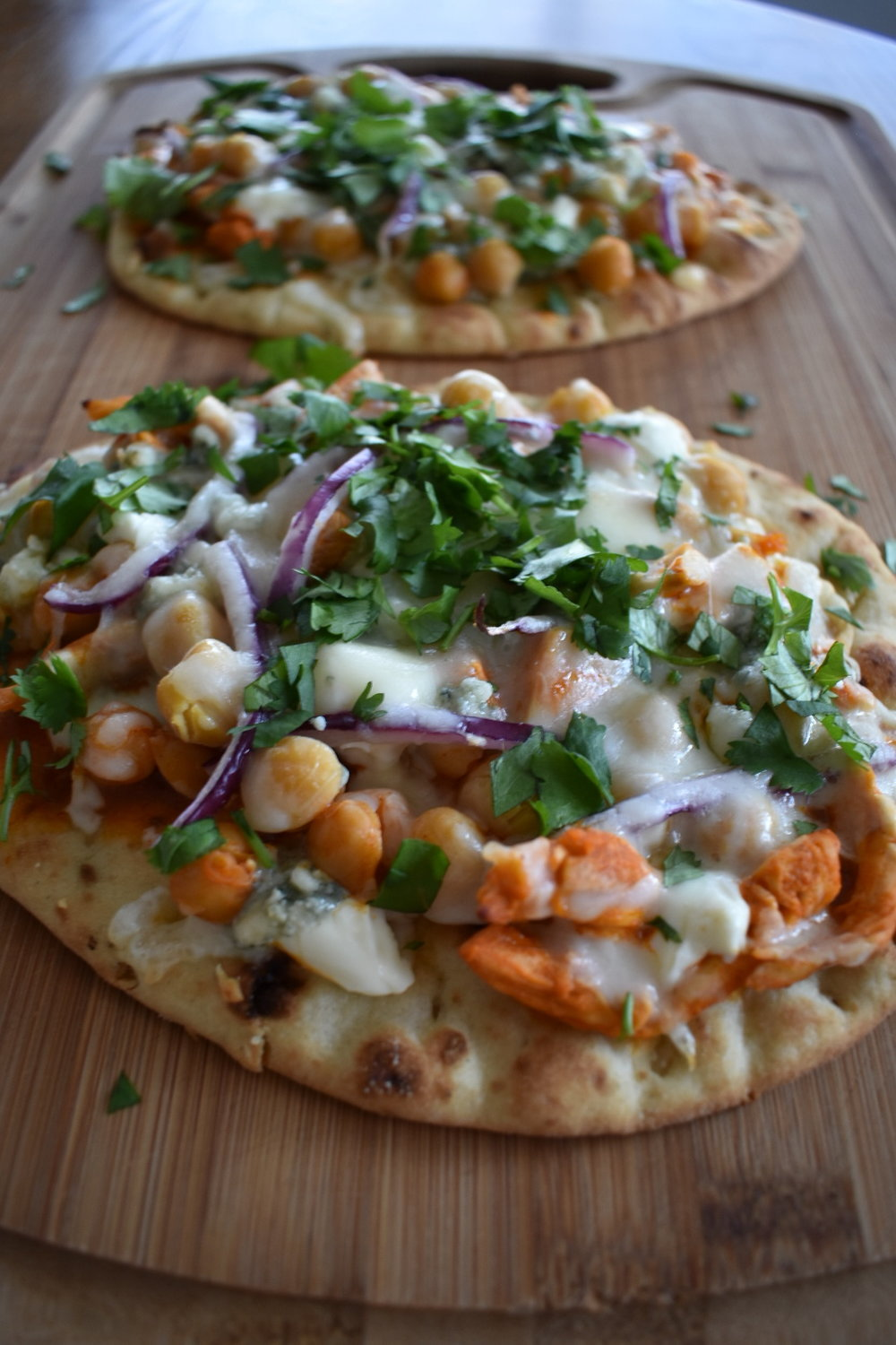 buffalo chicken naan pizza with chickpeas