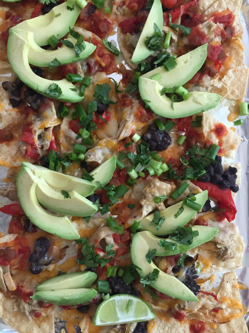 sheet pan nachos with vegetables and avocado