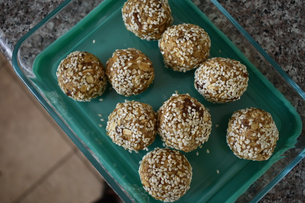 maple tahini balls packed up in storage container
