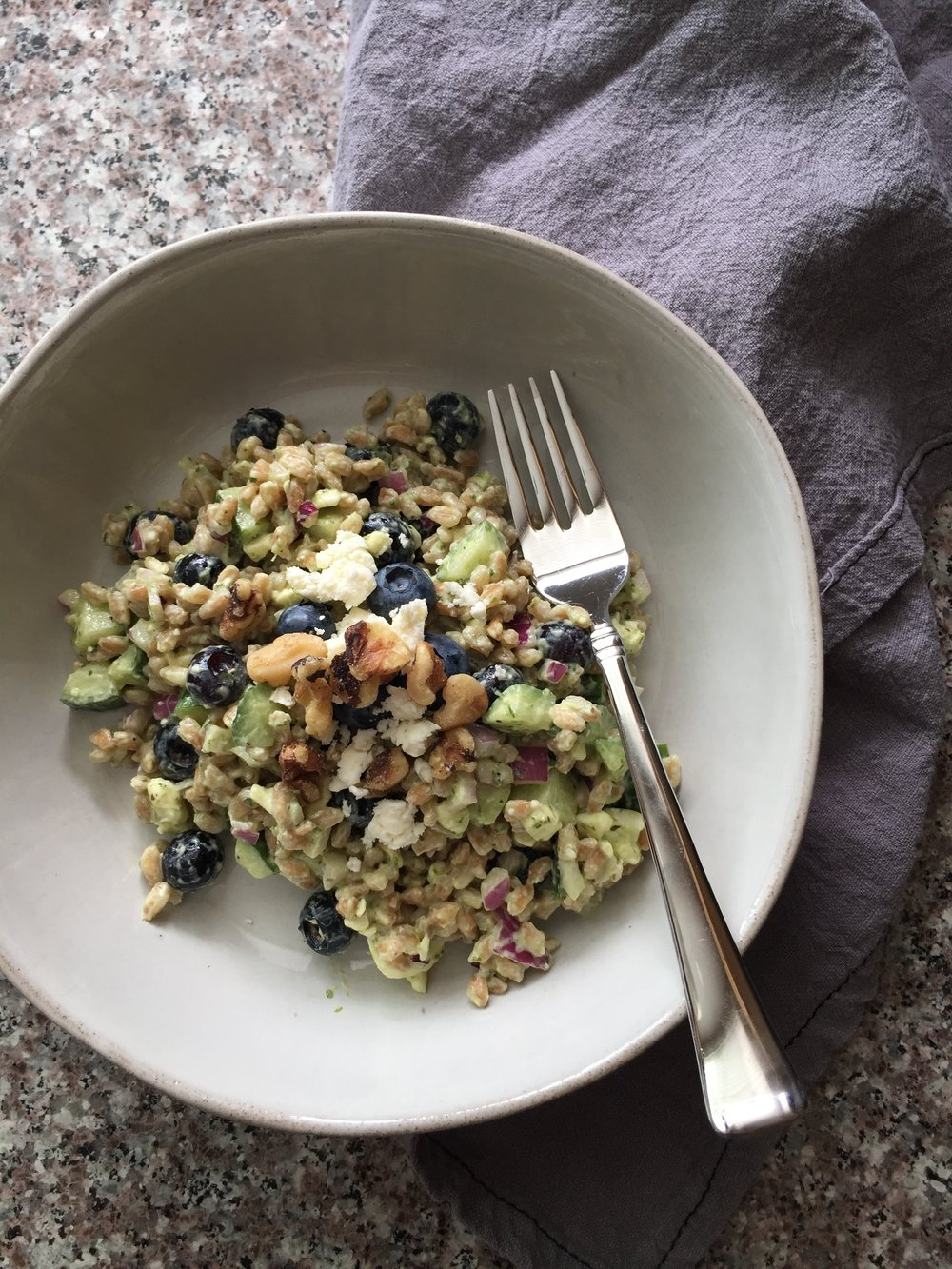 blueberry farro salad with creamy fresh herb dressing in a bowl