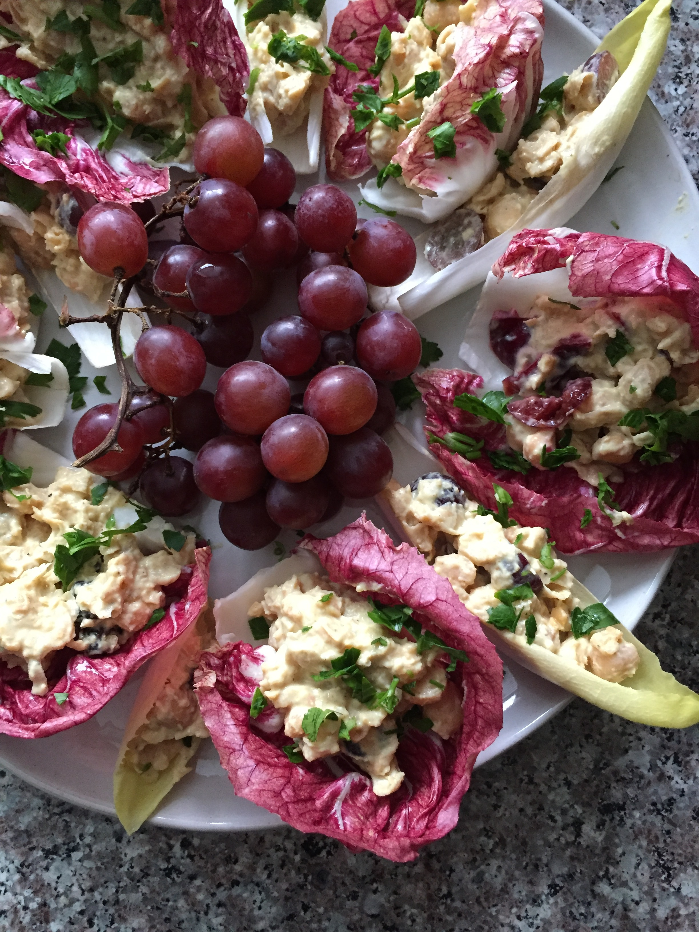curried chickpea salad served in radicchio and endive