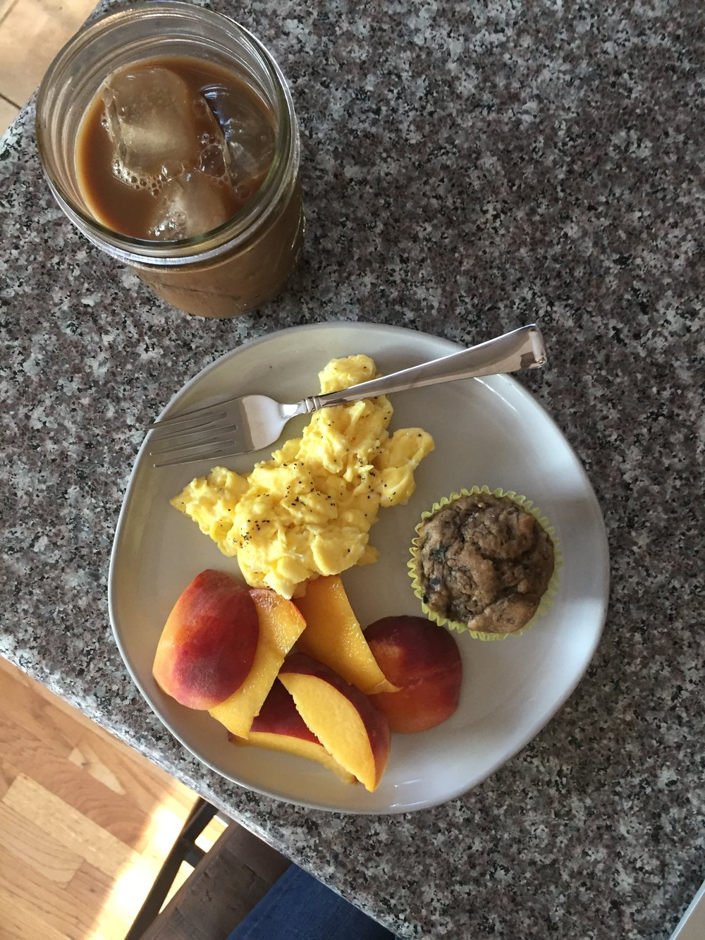 balanced breakfast of eggs, muffin and peach