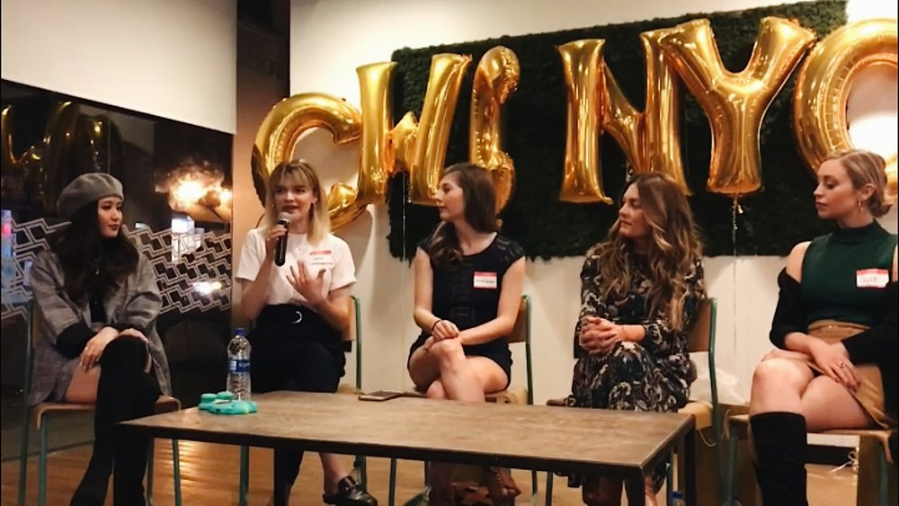 jessica whitaker at a hashtag paid event speaking about build + bloom