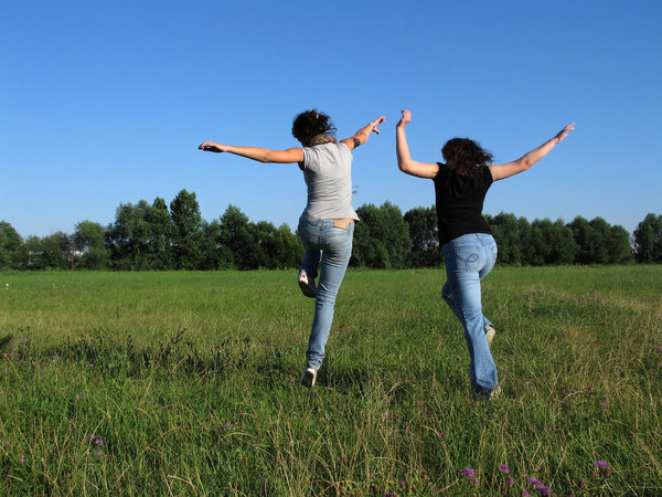 stock-image-joyful-women-running-in-field.jpg