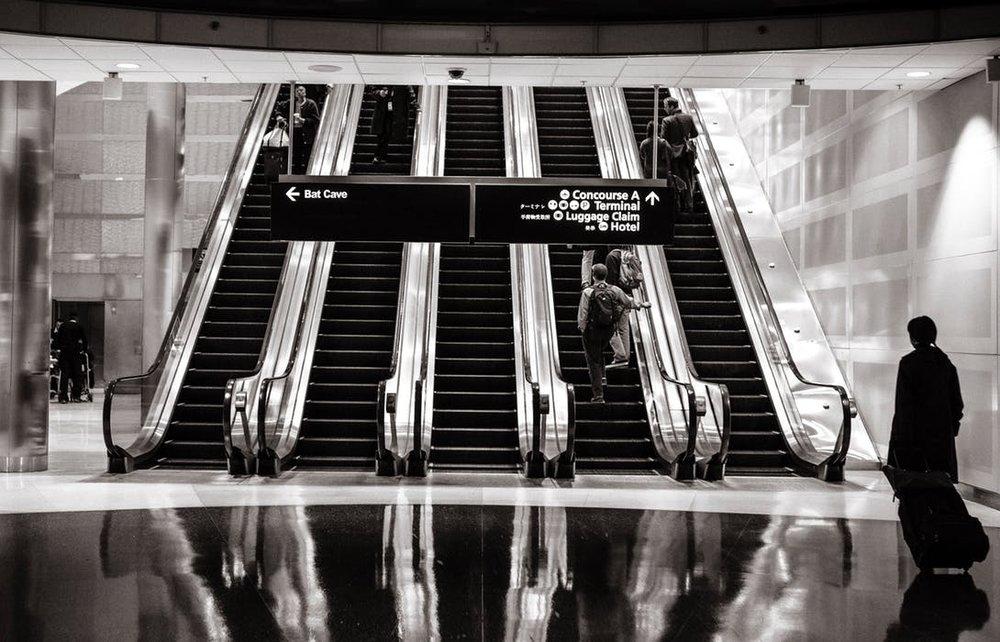 stairs-people-airport-escalators.jpg