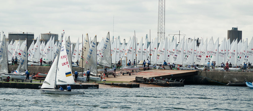 SAILING WORLD CHAMPIONSHIPS AARHUS 2018 - Inside the ropes at the most significant event for the Olympic classes between the Rio 2016 and Tokyo 2020 games.