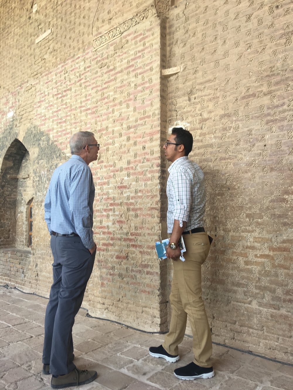 Jim & Reza inspecting ties