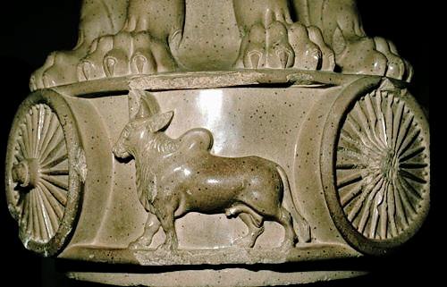Lion motif on base