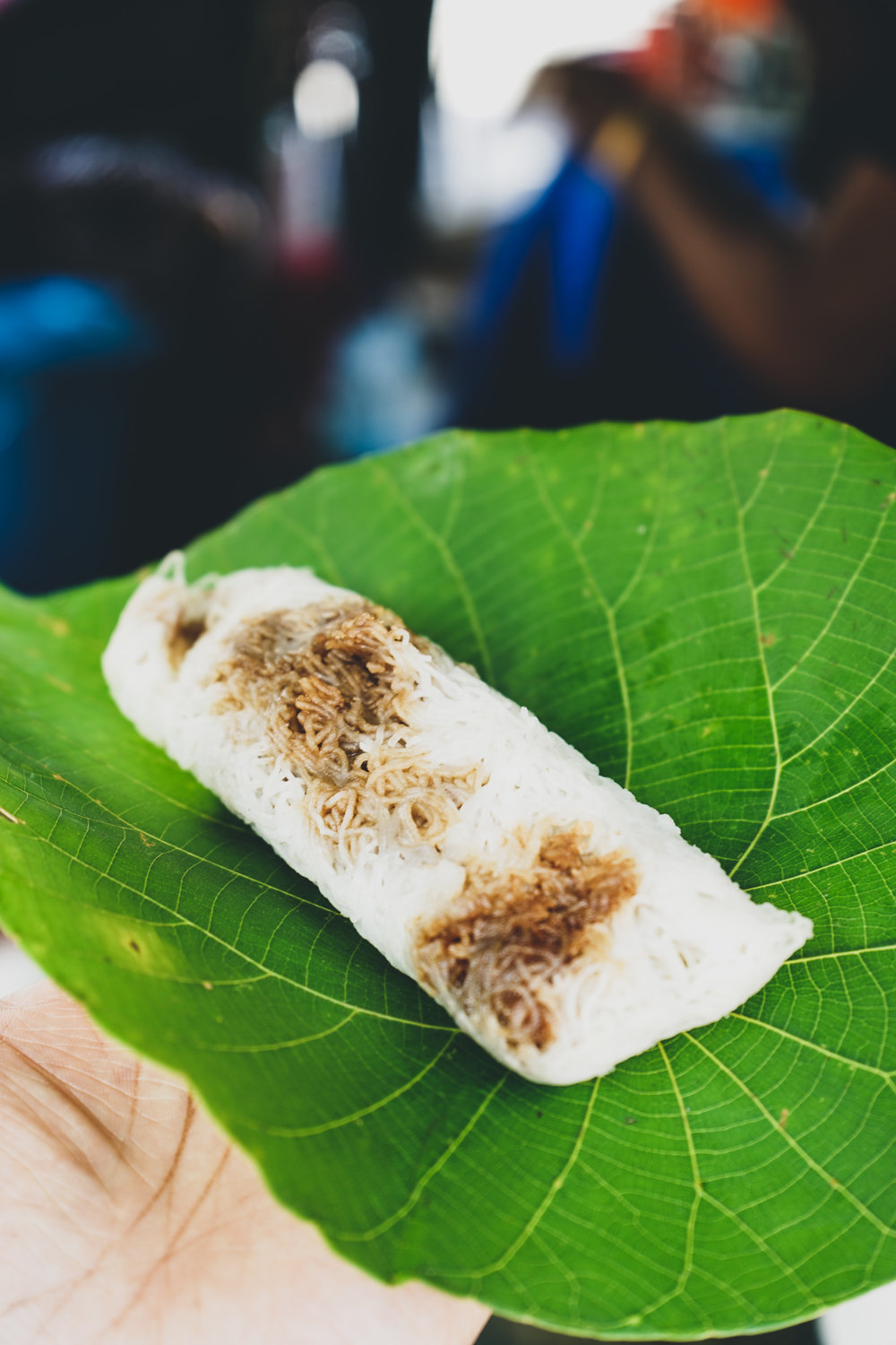 Colombo shopping guide - a delicious laviria at Good Market. The laviria is a jaggery-soaked coconut filling wrapped in a string hopper.