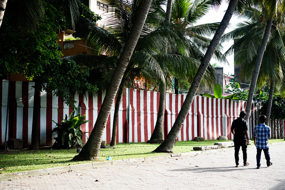 The distinctive red and white striped wall lets people know that this is a kovil