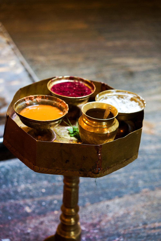 Brass pedestal of coloured pastes