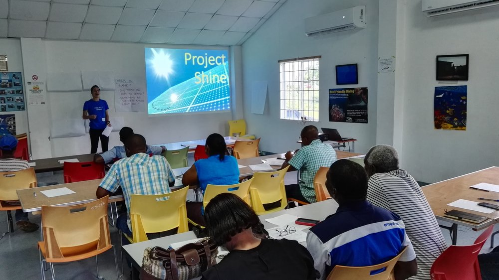 Kick off workshop for Project Shine led by Alexis Tubb of the Clinton Foundation, Sav-la-Mar, Westmoreland, August 2017. This workshop focused on community members who were interested in solar technology and received non-certification training.
